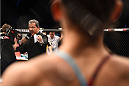 KRAKOW, POLAND - APRIL 11:  (L-R) Octagon announcer Bruce Buffer introduces Alexandra Albu of Russia before her women's strawweight fight against Izabela Badurek of Poland during the UFC Fight Night event at the Tauron Arena on April 11, 2015 in Krakow, Poland. (Photo by Jeff Bottari/Zuffa LLC/Zuffa LLC via Getty Images)
