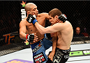 NEWARK, NJ - APRIL 18:  Diego Brandao and Jimy Hettes exchange blows in their featherweight bout during the UFC Fight Night event at Prudential Center on April 18, 2015 in Newark, New Jersey.  (Photo by Josh Hedges/Zuffa LLC/Zuffa LLC via Getty Images)