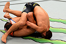 NEWARK, NJ - APRIL 18:  Luke Rockhold and Lyoto Machida of Brazil grapple in their middleweight bout during the UFC Fight Night event at Prudential Center on April 18, 2015 in Newark, New Jersey.  (Photo by Josh Hedges/Zuffa LLC/Zuffa LLC via Getty Images)
