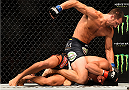 NEWARK, NJ - APRIL 18:  Luke Rockhold punches Lyoto Machida of Brazil in their middleweight bout during the UFC Fight Night event at Prudential Center on April 18, 2015 in Newark, New Jersey.  (Photo by Jeff Bottari/Zuffa LLC/Zuffa LLC via Getty Images)