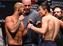 MONTREAL, QC - APRIL 24:   (L-R) Opponents Demetrious Johnson of the United States and Kyoji Horiguchi of Japan face off during the UFC 186 weigh-in at Metropolis on April 24, 2015 in Montreal, Quebec, Canada. (Photo by Josh Hedges/Zuffa LLC/Zuffa LLC via Getty Images)