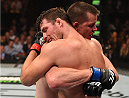 MONTREAL, QC - APRIL 25:   (L-R) Michael Bisping of England and CB Dollaway of the United States embrace after their middleweight bout during the UFC 186 event at the Bell Centre on April 25, 2015 in Montreal, Quebec, Canada. (Photo by Josh Hedges/Zuffa LLC/Zuffa LLC via Getty Images)