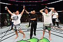 MONTREAL, QC - APRIL 25:   Michael Bisping (L) of England celebrates after his decision victory over CB Dollaway of the United States in their middleweight bout during the UFC 186 event at the Bell Centre on April 25, 2015 in Montreal, Quebec, Canada. (Photo by Josh Hedges/Zuffa LLC/Zuffa LLC via Getty Images)
