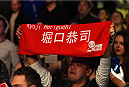 MONTREAL, QC - APRIL 25:   A fan holds a sign in support of Kyoji Horiguchi of Japan before his UFC flyweight championship bout against Demetrious Johnson during the UFC 186 event at the Bell Centre on April 25, 2015 in Montreal, Quebec, Canada. (Photo by Josh Hedges/Zuffa LLC/Zuffa LLC via Getty Images)