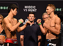 ADELAIDE, AUSTRALIA - MAY 09:   (L-R) Opponents Hatsu Hioki of Japan and Daniel Hooker of New Zealand face off during the UFC weigh-in event at the Adelaide Entertainment Centre on May 9, 2015 in Adelaide, Australia. (Photo by Josh Hedges/Zuffa LLC/Zuffa LLC via Getty Images)