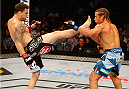 MANILA, PHILIPPINES - MAY 16: Frankie Edgar of the United States throws a kick at Uriah Faber of the United States in their featherweight fight during the UFC Fight Night event at the Mall of Asia Arena on May 16, 2015 in Manila, Philippines. (Photo by Mitch Viquez/Zuffa LLC/Zuffa LLC via Getty Images)