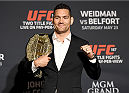 LAS VEGAS, NEVADA - MAY 21: Chris Weidman poses with the belt during the UFC 187 Ultimate Media Day at the MGM Grand Hotel/Casino on May 21, 2015 in Las Vegas Nevada. (Photo by Brandon Magnus/Zuffa LLC/Zuffa LLC via Getty Images)