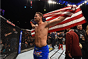LAS VEGAS, NV - MAY 23:  Chris Weidman reacts to his victory over Vitor Belfort of Brazil in their UFC middleweight championship bout during the UFC 187 event at the MGM Grand Garden Arena on May 23, 2015 in Las Vegas, Nevada.  (Photo by Josh Hedges/Zuffa LLC/Zuffa LLC via Getty Images)