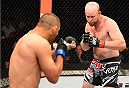 NEW ORLEANS, LA - JUNE 06:   (R-l) Tim Boetsch circles Dan Henderson in their middleweight bout during the UFC event at the Smoothie King Center on June 6, 2015 in New Orleans, Louisiana. (Photo by Josh Hedges/Zuffa LLC/Zuffa LLC via Getty Images)