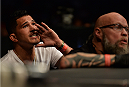 MEXICO CITY, MEXICO - JUNE 13:  Anthony Pettis corners Chico Camus of the United States in between rounds while facing Henry Cejudo of the United States in their flyweight bout during the UFC 188 event at the Arena Ciudad de Mexico on June 13, 2015 in Mexico City, Mexico. (Photo by Josh Hedges/Zuffa LLC/Zuffa LLC via Getty Images)