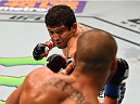 MEXICO CITY, MEXICO - JUNE 13:  (L-R) Gilbert Melendez of the United States punches Eddie Alvarez of the United Statesin their lightweight bout during the UFC 188 event at the Arena Ciudad de Mexico on June 13, 2015 in Mexico City, Mexico. (Photo by Josh Hedges/Zuffa LLC/Zuffa LLC via Getty Images)