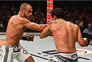 MEXICO CITY, MEXICO - JUNE 13:  (L-R) Eddie Alvarez of the United States punches Gilbert Melendez of the United States in their lightweight bout during the UFC 188 event at the Arena Ciudad de Mexico on June 13, 2015 in Mexico City, Mexico. (Photo by Josh Hedges/Zuffa LLC/Zuffa LLC via Getty Images)