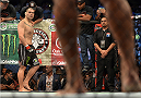 MEXICO CITY, MEXICO - JUNE 13:   (L-R) Cain Velasquez of the United States stands in the Octagon across from Fabricio Werdum of Brazil in their UFC heavyweight championship bout during the UFC 188 event inside the Arena Ciudad de Mexico on June 13, 2015 in Mexico City, Mexico. (Photo by Josh Hedges/Zuffa LLC/Zuffa LLC via Getty Images)