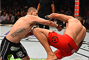 MEXICO CITY, MEXICO - JUNE 13:   (L-R) Cain Velasquez of the United States punches Fabricio Werdum of Brazil in their UFC heavyweight championship bout during the UFC 188 event inside the Arena Ciudad de Mexico on June 13, 2015 in Mexico City, Mexico. (Photo by Josh Hedges/Zuffa LLC/Zuffa LLC via Getty Images)