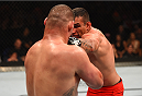 MEXICO CITY, MEXICO - JUNE 13:   (R-L) Fabricio Werdum of Brazil punches Cain Velasquez of the United States in their UFC heavyweight championship bout during the UFC 188 event inside the Arena Ciudad de Mexico on June 13, 2015 in Mexico City, Mexico. (Photo by Josh Hedges/Zuffa LLC/Zuffa LLC via Getty Images)