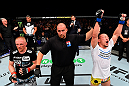 BERLIN, GERMANY - JUNE 20:  (R-L) Tatsuya Kawajiri of Japan celebrates after defeating Dennis Siver in their featherweight bout during the UFC Fight Night event at the O2 World on June 20, 2015 in Berlin, Germany. (Photo by Josh Hedges/Zuffa LLC/Zuffa LLC via Getty Images)
