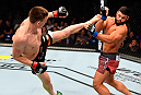 BERLIN, GERMANY - JUNE 20:  (L-R) Scott Askham of England kicks Antonio dos Santos of Brazil in their middleweight bout during the UFC Fight Night event at the O2 World on June 20, 2015 in Berlin, Germany. (Photo by Josh Hedges/Zuffa LLC/Zuffa LLC via Getty Images)