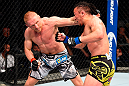BERLIN, GERMANY - JUNE 20:  (L-R) Dennis Siver of Germany punches Tatsuya Kawajiri of Japan in their featherweight bout during the UFC Fight Night event at the O2 World on June 20, 2015 in Berlin, Germany. (Photo by Josh Hedges/Zuffa LLC/Zuffa LLC via Getty Images)