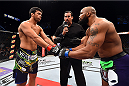 HOLLYWOOD, FL - JUNE 27:   (L-R) Lyoto Machida of Brazil and Yoel Romero of Cuba touch gloves before their middleweight during the UFC Fight Night event at the Hard Rock Live on June 27, 2015 in Hollywood, Florida. (Photo by Josh Hedges/Zuffa LLC/Zuffa LLC via Getty Images)