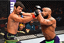 HOLLYWOOD, FL - JUNE 27:  (R-L) Yoel Romero of Cuba punches Lyoto Machida of Brazil in their middleweight during the UFC Fight Night event at the Hard Rock Live on June 27, 2015 in Hollywood, Florida. (Photo by Josh Hedges/Zuffa LLC/Zuffa LLC via Getty Images)