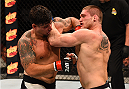 SAN DIEGO, CA - JULY 15:   (L-R) Frank Mir punches and knocks out Todd Duffee in their heavyweight bout during the UFC event at the Valley View Casino Center on July 15, 2015 in San Diego, California. (Photo by Jeff Bottari/Zuffa LLC/Zuffa LLC via Getty Images)