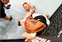 GLASGOW, SCOTLAND - JULY 18:  (R-L) Paddy Holohan of Ireland attempts to secure a triangle choke submission against Vaughan Lee of England in their flyweight fight during the UFC Fight Night event inside the SSE Hydro on July 18, 2015 in Glasgow, Scotland.  (Photo by Josh Hedges/Zuffa LLC/Zuffa LLC via Getty Images)