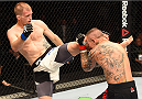 GLASGOW, SCOTLAND - JULY 18:  (L-R) Evan Dunham of the United States kicks Ross Pearson of England in their lightweight fight during the UFC Fight Night event inside the SSE Hydro on July 18, 2015 in Glasgow, Scotland.  (Photo by Josh Hedges/Zuffa LLC/Zuffa LLC via Getty Images)
