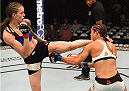 CHICAGO, IL - JULY 25:   (L-R) Jessamyn Duke kicks Elizabeth Phillips in their women's bantamweight bout during the UFC event at the United Center on July 25, 2015 in Chicago, Illinois. (Photo by Jeff Bottari/Zuffa LLC/Zuffa LLC via Getty Images)
