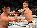 CHICAGO, IL - JULY 25:   (R-L) James Krause punches Daron Cruickshank in their lightweight bout during the UFC event at the United Center on July 25, 2015 in Chicago, Illinois. (Photo by Jeff Bottari/Zuffa LLC/Zuffa LLC via Getty Images)