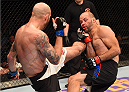 CHICAGO, IL - JULY 25:   (L-R) Ben Saunders kicks Kenny Robertson in their welterweight bout during the UFC event at the United Center on July 25, 2015 in Chicago, Illinois. (Photo by Jeff Bottari/Zuffa LLC/Zuffa LLC via Getty Images)