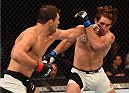CHICAGO, IL - JULY 25:   (L-R) Gian Villante punches Tom Lawlor in their light heavyweight bout during the UFC event at the United Center on July 25, 2015 in Chicago, Illinois. (Photo by Jeff Bottari/Zuffa LLC/Zuffa LLC via Getty Images)