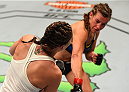 CHICAGO, IL - JULY 25:   (R-L) Miesha Tate drops Jessica Eye with a punch in their women's bantamweight bout during the UFC event at the United Center on July 25, 2015 in Chicago, Illinois. (Photo by Jeff Bottari/Zuffa LLC/Zuffa LLC via Getty Images)