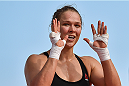 RIO DE JANEIRO, BRAZIL - JULY 29:  Womens bantamweight champion Ronda Rousey of the United States nods to fans during open training session at Pepe Beach on July 29, 2015 in Rio de Janeiro, Brazil.  (Photo by Buda Mendes/Zuffa LLC/Zuffa LLC via Getty Images)