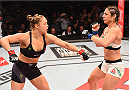 RIO DE JANEIRO, BRAZIL - AUGUST 01:  (L-R) Ronda Rousey of the United States throws a punch at Bethe Correia of Brazil in their UFC women's bantamweight championship bout during the UFC 190 event inside HSBC Arena on August 1, 2015 in Rio de Janeiro, Brazil.  (Photo by Josh Hedges/Zuffa LLC/Zuffa LLC via Getty Images)