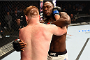 NASHVILLE, TN - AUGUST 08:  (L-R) Sam Alvey grapples with Derek Brunson in their middleweight bout during the UFC Fight Night event at Bridgestone Arena on August 8, 2015 in Nashville, Tennessee.  (Photo by Josh Hedges/Zuffa LLC/Zuffa LLC via Getty Images)