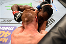 NASHVILLE, TN - AUGUST 08:  (R-L) Derek Brunson punches Sam Alvey in their middleweight bout during the UFC Fight Night event at Bridgestone Arena on August 8, 2015 in Nashville, Tennessee.  (Photo by Josh Hedges/Zuffa LLC/Zuffa LLC via Getty Images)
