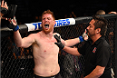 NASHVILLE, TN - AUGUST 08:  (L-R) Sam Alvey contests his loss to referee Mario Yamasaki after losing to Derek Brunson in their middleweight bout during the UFC Fight Night event at Bridgestone Arena on August 8, 2015 in Nashville, Tennessee.  (Photo by Josh Hedges/Zuffa LLC/Zuffa LLC via Getty Images)
