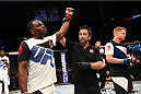 NASHVILLE, TN - AUGUST 08:  (L-R) Derek Brunson celebrates after defeating Sam Alvey in their middleweight bout during the UFC Fight Night event at Bridgestone Arena on August 8, 2015 in Nashville, Tennessee.  (Photo by Josh Hedges/Zuffa LLC/Zuffa LLC via Getty Images)