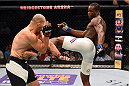 NASHVILLE, TN - AUGUST 08:  (R-L) Ovince Saint Preux kicks Glover Teixeira of Brazil in their light heavyweight bout during the UFC Fight Night event at Bridgestone Arena on August 8, 2015 in Nashville, Tennessee.  (Photo by Josh Hedges/Zuffa LLC/Zuffa LLC via Getty Images)