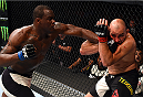 NASHVILLE, TN - AUGUST 08:  (L-R) Ovince Saint Preux punches Glover Teixeira of Brazil in their light heavyweight bout during the UFC Fight Night event at Bridgestone Arena on August 8, 2015 in Nashville, Tennessee.  (Photo by Josh Hedges/Zuffa LLC/Zuffa LLC via Getty Images)