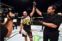 NASHVILLE, TN - AUGUST 08:  Glover Teixeira of Brazil celebrates after defeating Ovince Saint Preux in their light heavyweight bout during the UFC Fight Night event at Bridgestone Arena on August 8, 2015 in Nashville, Tennessee.  (Photo by Josh Hedges/Zuffa LLC/Zuffa LLC via Getty Images)