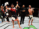 SASKATOON, SK - AUGUST 23:  Patrick Cote (L) celebrates after his TKO victory over Josh Burkman in their welterweight bout during the UFC event at the SaskTel Centre on August 23, 2015 in Saskatoon, Saskatchewan, Canada. (Photo by Jeff Bottari/Zuffa LLC/Zuffa LLC via Getty Images)
