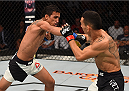 SASKATOON, SK - AUGUST 23:  (L-R) Charles Oliveira of Brazil punches Max Holloway of the United States in their featherweight bout during the UFC event at the SaskTel Centre on August 23, 2015 in Saskatoon, Saskatchewan, Canada. (Photo by Jeff Bottari/Zuffa LLC/Zuffa LLC via Getty Images)