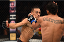 SASKATOON, SK - AUGUST 23:  (L-R) Max Holloway of the United States punches Charles Oliveira of Brazil in their featherweight bout during the UFC event at the SaskTel Centre on August 23, 2015 in Saskatoon, Saskatchewan, Canada. (Photo by Jeff Bottari/Zuffa LLC/Zuffa LLC via Getty Images)