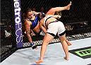 LAS VEGAS, NV - SEPTEMBER 05: (R-L) Jessica Andrade takes down Raquel Pennington in their women's bantamweight bout during the UFC 191 event inside MGM Grand Garden Arena on September 5, 2015 in Las Vegas, Nevada.  (Photo by Jeff Bottari/Zuffa LLC/Zuffa LLC via Getty Images) *** Local Caption *** Jessica Andrade; Raquel Pennington