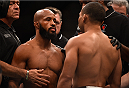 LAS VEGAS, NV - SEPTEMBER 05: (L-R) Demetrious Johnson and John Dodson face off in their flyweight championship bout during the UFC 191 event inside MGM Grand Garden Arena on September 5, 2015 in Las Vegas, Nevada.  (Photo by Jeff Bottari/Zuffa LLC/Zuffa LLC via Getty Images) *** Local Caption *** Demetrious Johnson; John Dodson