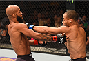 LAS VEGAS, NV - SEPTEMBER 05: (R-L) John Dodson punches Demetrious Johnson in their flyweight championship bout during the UFC 191 event inside MGM Grand Garden Arena on September 5, 2015 in Las Vegas, Nevada.  (Photo by Josh Hedges/Zuffa LLC/Zuffa LLC via Getty Images) *** Local Caption *** Demetrious Johnson; John Dodson