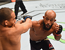 LAS VEGAS, NV - SEPTEMBER 05: (R-L) Demetrious Johnson punches John Dodson in their flyweight championship bout during the UFC 191 event inside MGM Grand Garden Arena on September 5, 2015 in Las Vegas, Nevada.  (Photo by Josh Hedges/Zuffa LLC/Zuffa LLC via Getty Images) *** Local Caption *** Demetrious Johnson; John Dodson