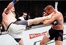 SAITAMA, JAPAN - SEPTEMBER 27: Roy Nelson of the United States of America kicks Josh Barnett of the United States of America in their heavyweight bout during the UFC event at the Saitama Super Arena on September 27, 2015 in Saitama, Japan. (Photo by Mitch Viquez/Zuffa LLC/Zuffa LLC via Getty Images)