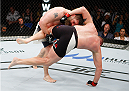 SAITAMA, JAPAN - SEPTEMBER 27:  Roy Nelson of the United States of America takes down Josh Barnett of the United States of America in their heavyweight bout during the UFC event at the Saitama Super Arena on September 27, 2015 in Saitama, Japan. (Photo by Mitch Viquez/Zuffa LLC/Zuffa LLC via Getty Images)